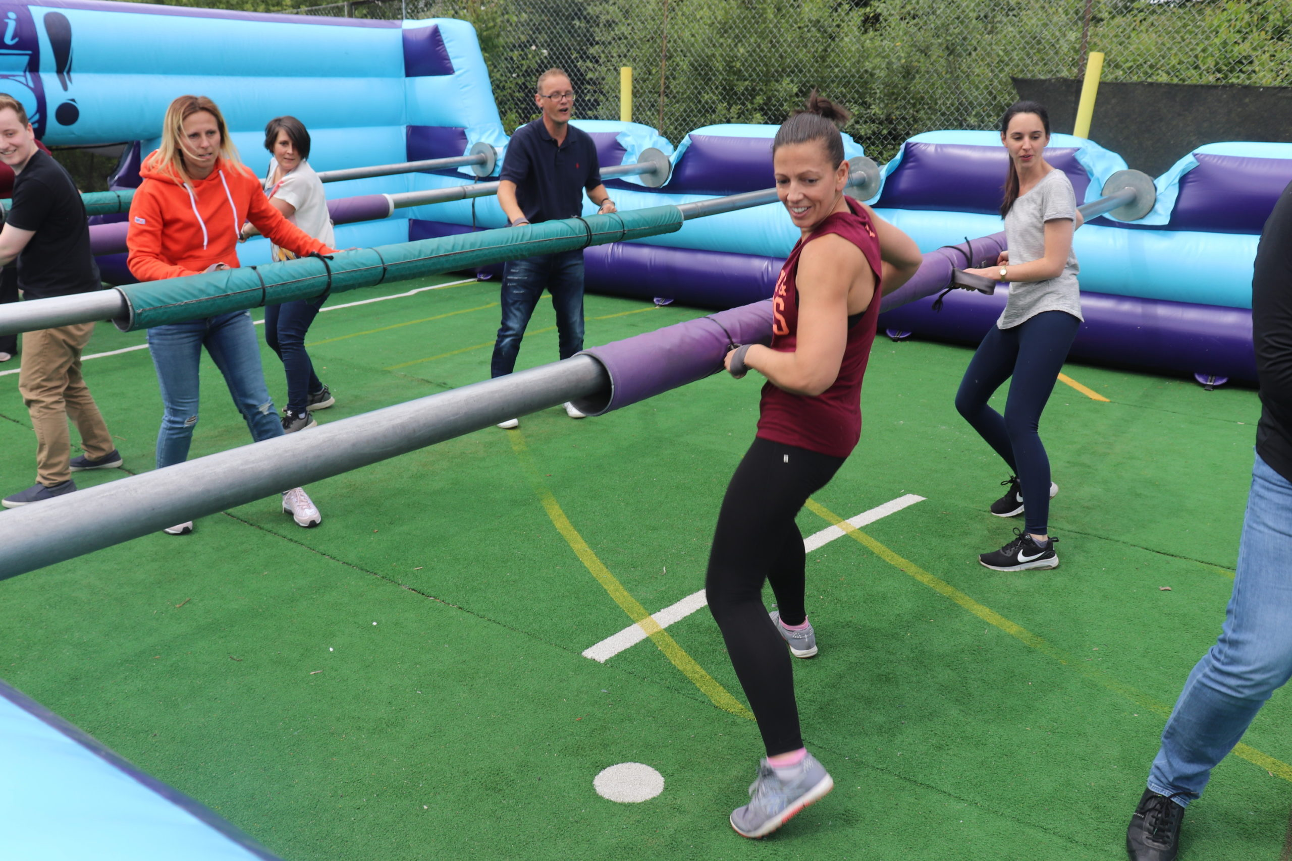 school team building activity human table football teams go head to head in this 5 a side game
