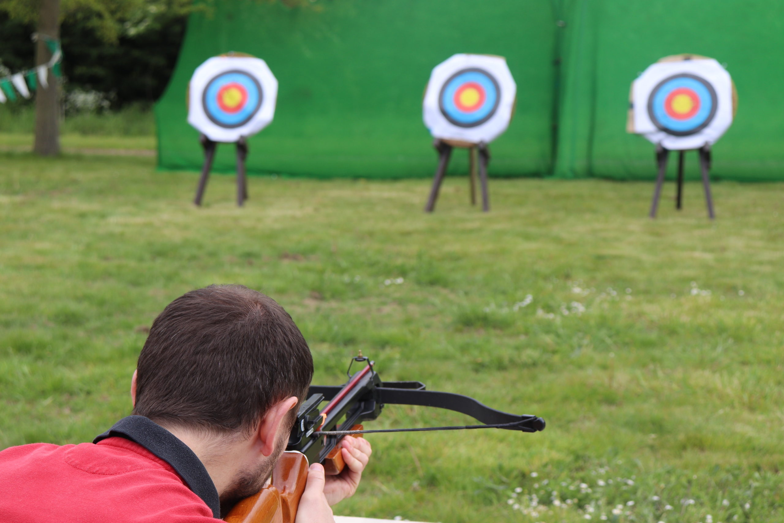 activities gallery with shooting at the target using our latest crossbow, hit the gold to score the team 10 points