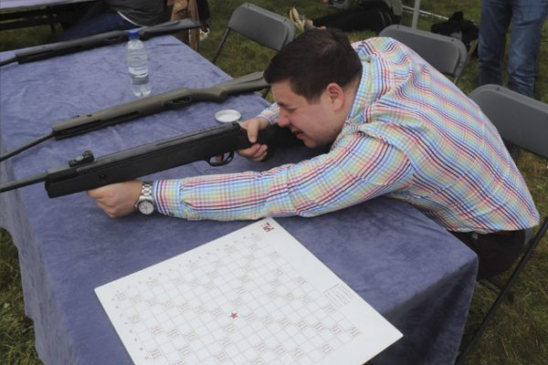 Activities gallery with team member shooting at the aphabet target with our .22 air rifle